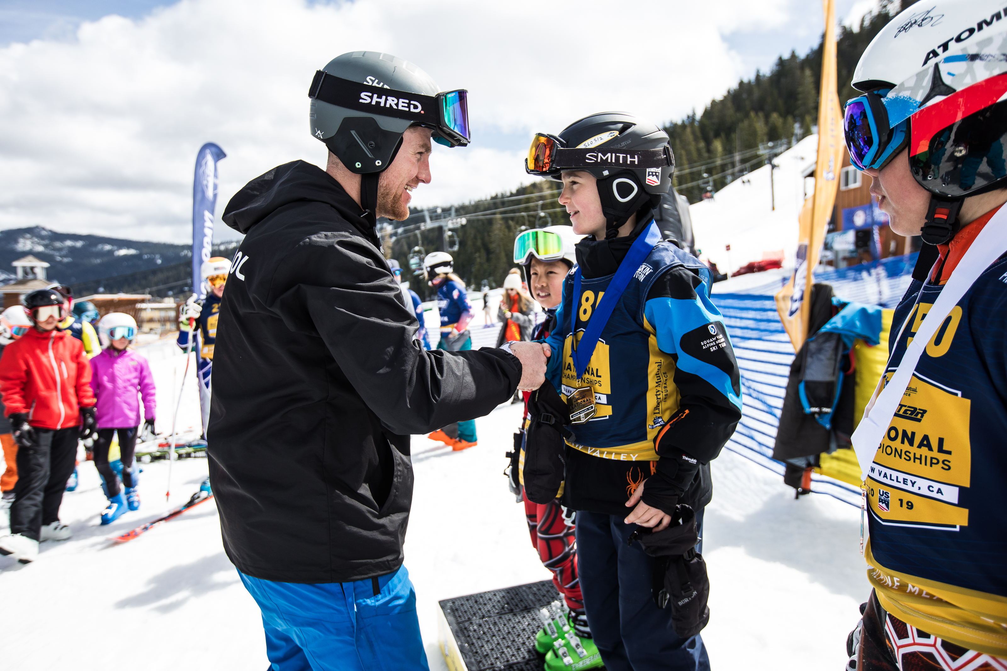 National Pacesetter and U.S. Ski Team member RCS hands out medals during Race of Champions
